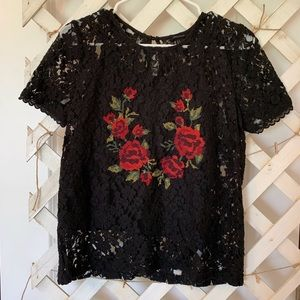 Black lace top with stitched rose details